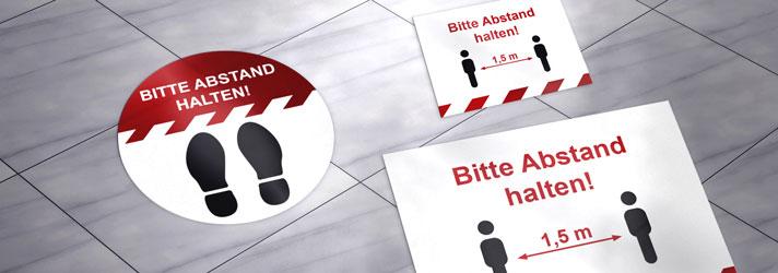 Fußbodenaufkleber mit Hinweis 'Bitte Abstand halten' online drucken lassen - Bei print24